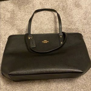 Black coach purse with gold details